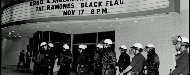 Anticipating the worst, police patrol outside of The Palladium while The Ramones and Black Flag are playing a concert inside. (Photo by Gary Leonard/Corbis via Getty Images)